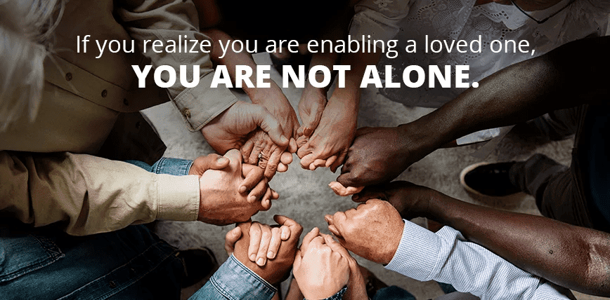 "Image of a bunch of people holding hands with the text: "" If you realize you are enabling a loved on, YOU ARE NOT ALONE"""